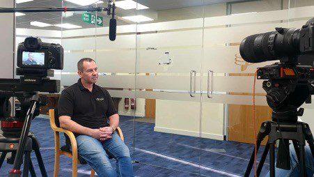 Wildix Staff Member being interviewed in office environment.